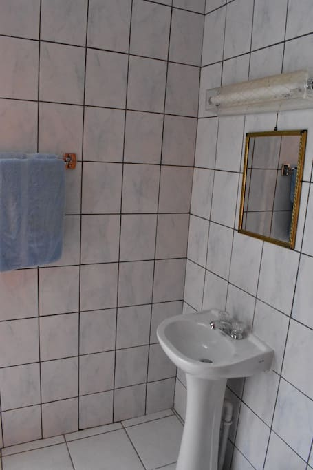 Bathroom with sink, miror and towels
