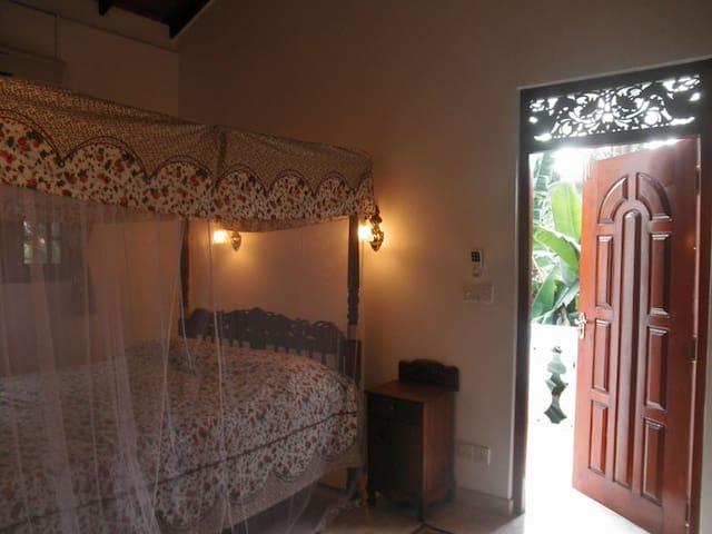 Bedroom with a door to the balcony.