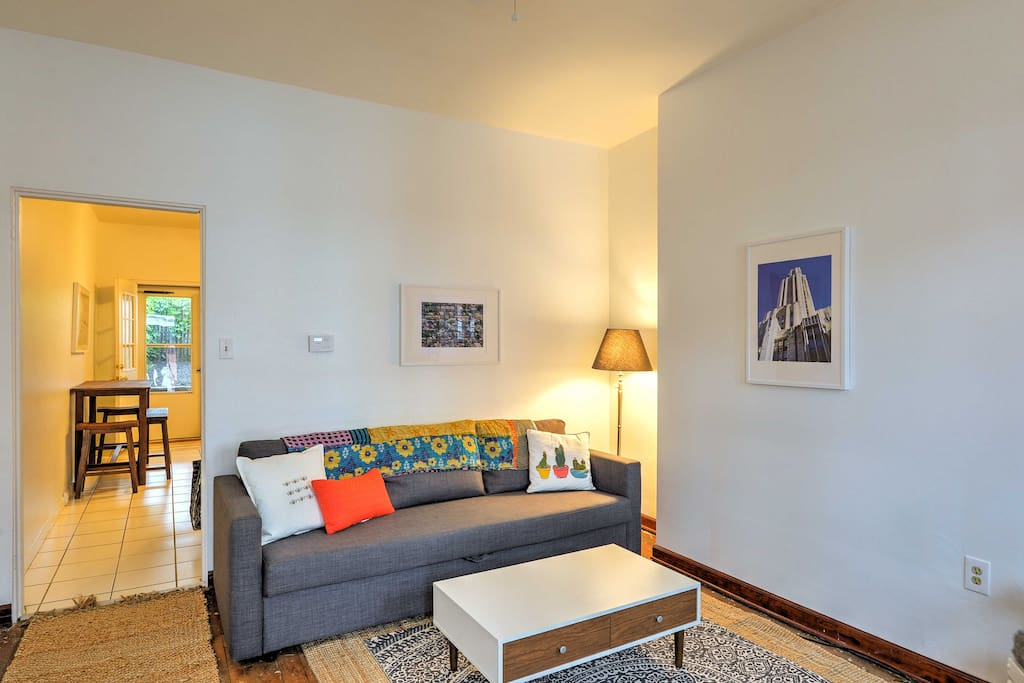 The home's cozy interior features simplistic decor and comfortable furnishings.