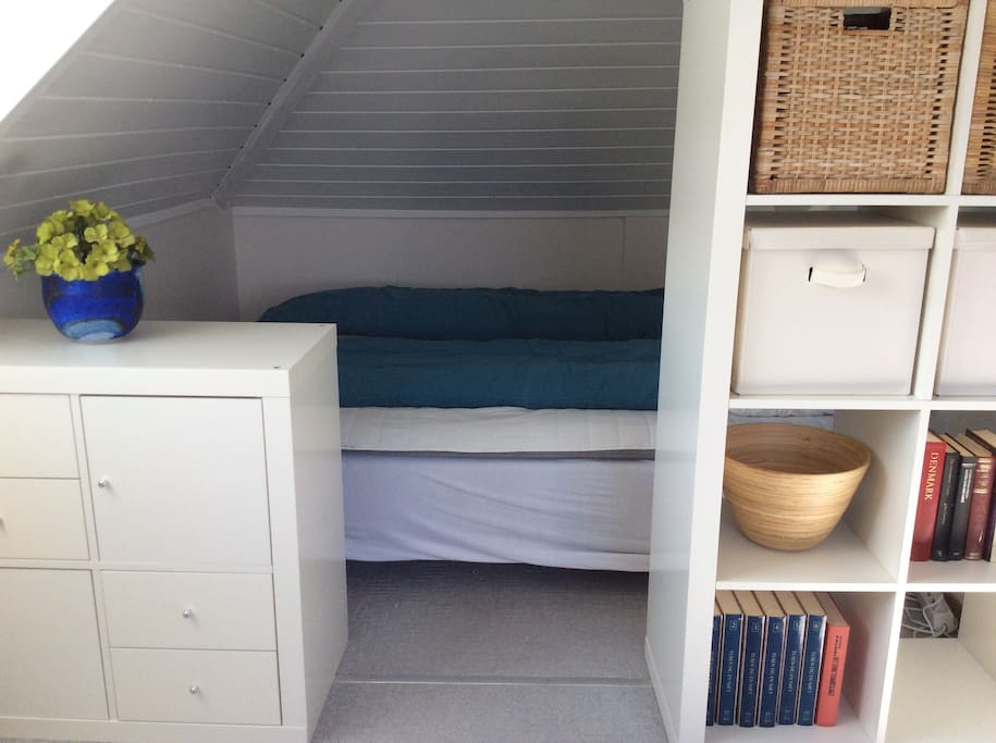 Secluded alcove with a queen size bed with room for two.