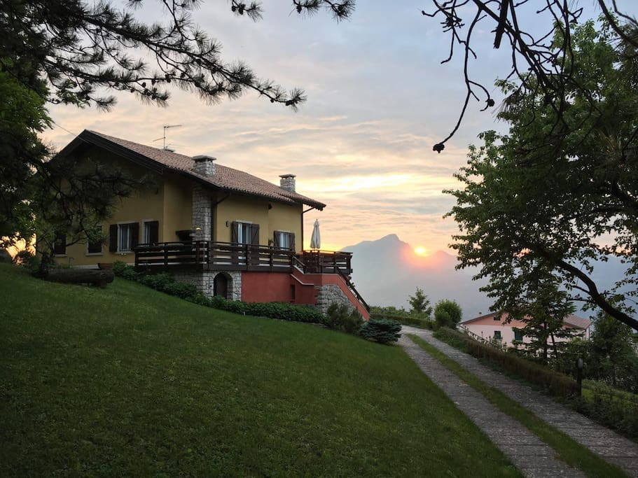 Inspiring Italian villa with private wood and astonishing Garda Lake view.