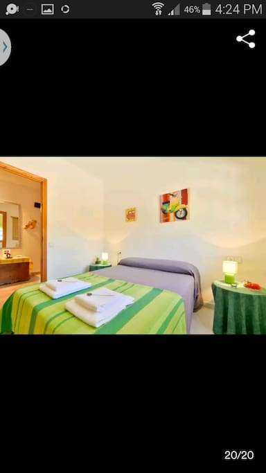 Discover a charming room equipped with a big ventilator and mosquito fans. A complete set of towels and a bottle of water are also included in the offer.