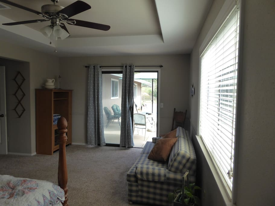 Master bedroom has sliding door to patio