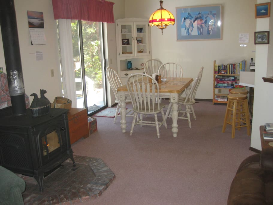 Dining area off the deck, with mountain view.  You will love wood burning stove!