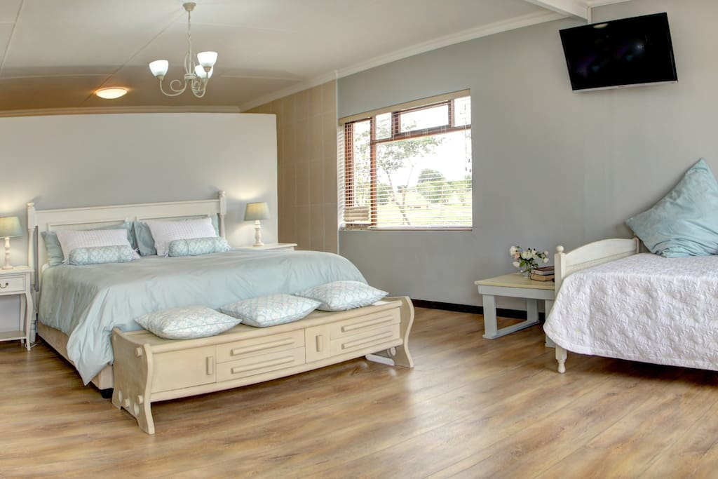 Room 3 - King sized bed, with shower, Jacuzzi bath , double basin and toilet. Air conditioning and Cable TV in Room