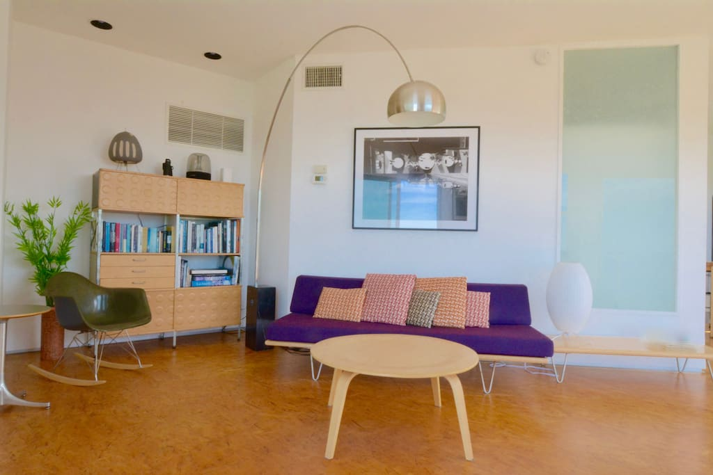 Living room with George Nelson couch, Eames coffee table, rocker and storage unit.