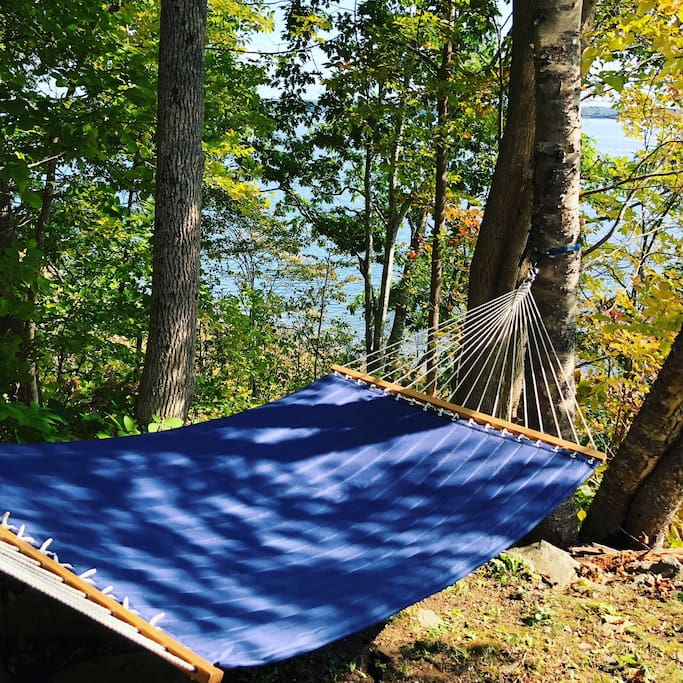 Relax on an extra-large hammock with ocean and forest views.