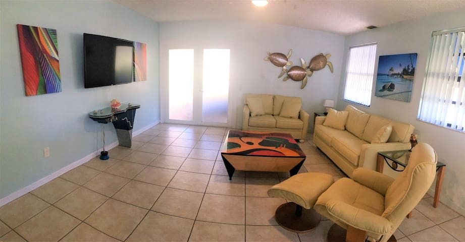 Comfortable living room is open to kitchen and has a queen size pull out couch