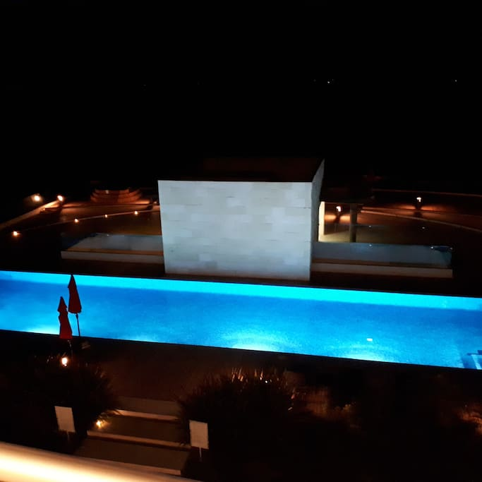 night view of the roof pool from the apartment.