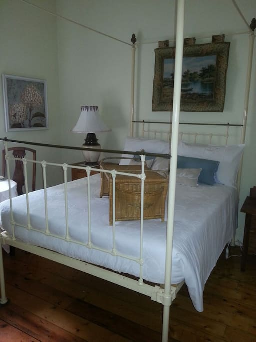 Victorian cast iron four poster double bed, set in very romantic room, looking out to attrim and garden.