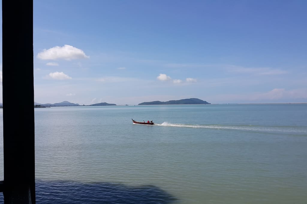 Once in a while fishermen's boats pass by.