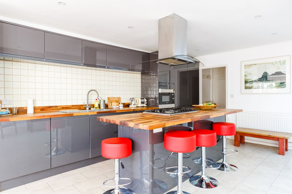 Large light kitchen with cool breakfast bar