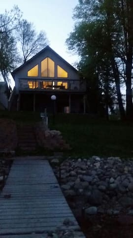 View from the lake to the house at nightfall....