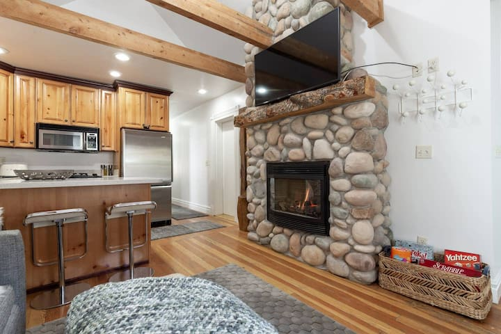 A full kitchen which is open to the living room with a fireplace that brings warmth and ambience to entire area. The kitchen/living room is a smaller space nicely accommodating up to four people but tight for six.       Photo Verified by Airbnb