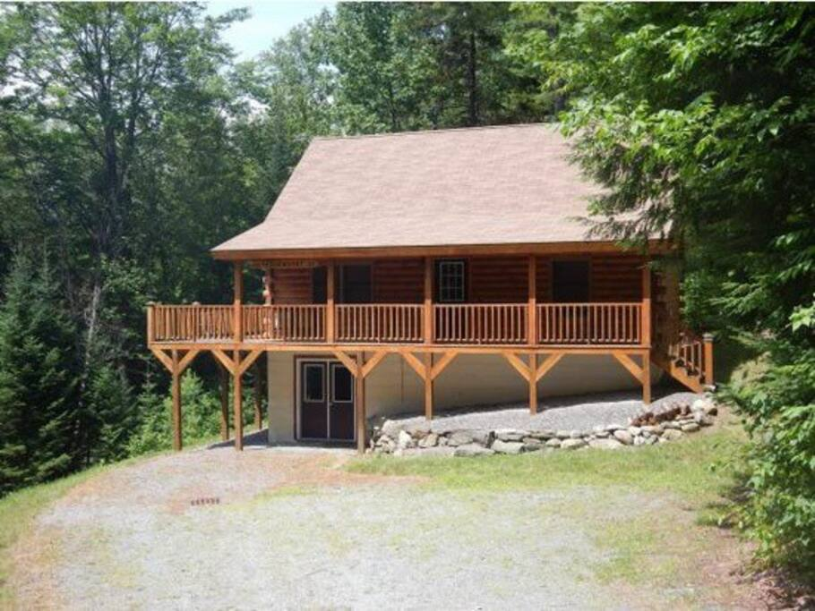 Log Cabin Home with wrap around porch.