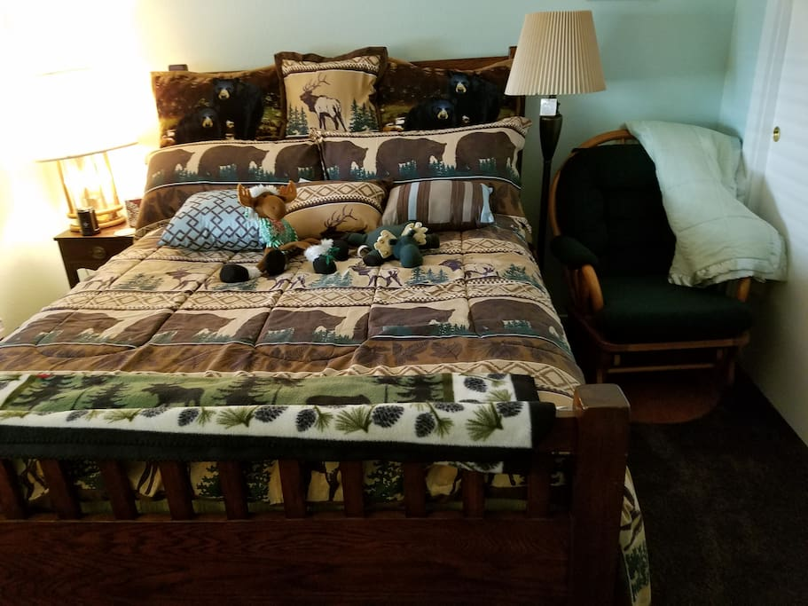 Queen bedroom with moose,bear and deer decor with glider rocker,Bear/Moose theme room