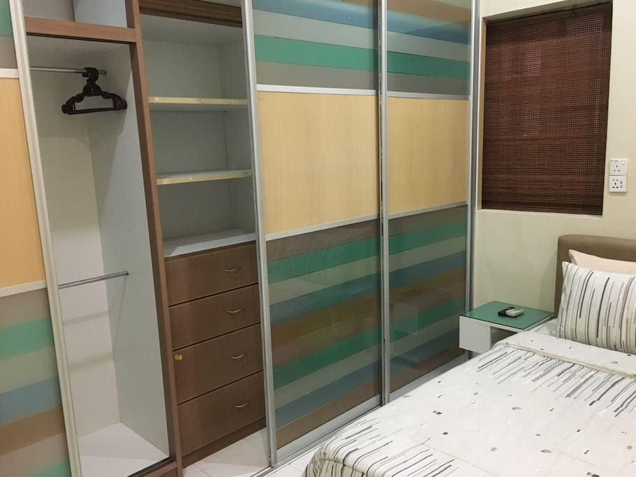 Wardrobe & drawers that guest can use. Owner keep their private stuff in the closed compartment.