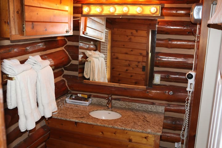 Bathroom with Marble Sink, Towels, Hair Dryer and Soap & Shampoo