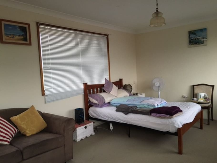 this is your bedroom with sofa, TV & aircon