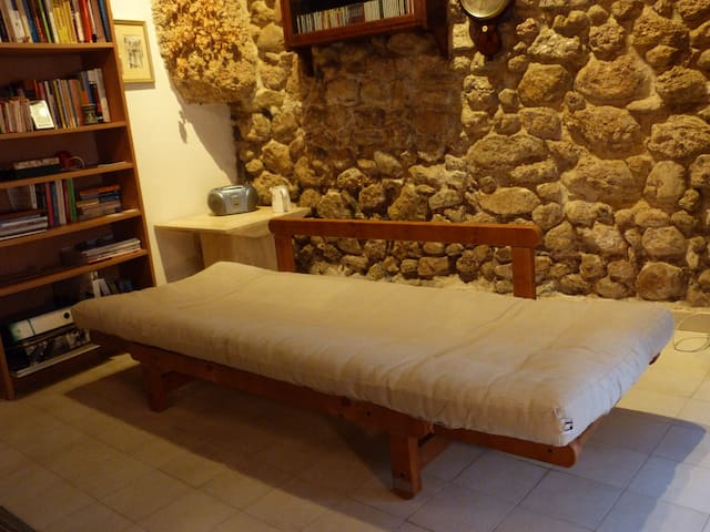Divano converted into single bed for a third guest.