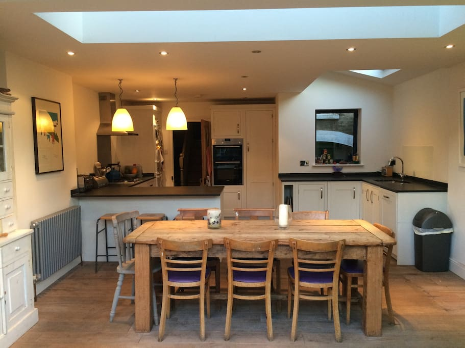 Open-plan kitchen and dining table that seats ten