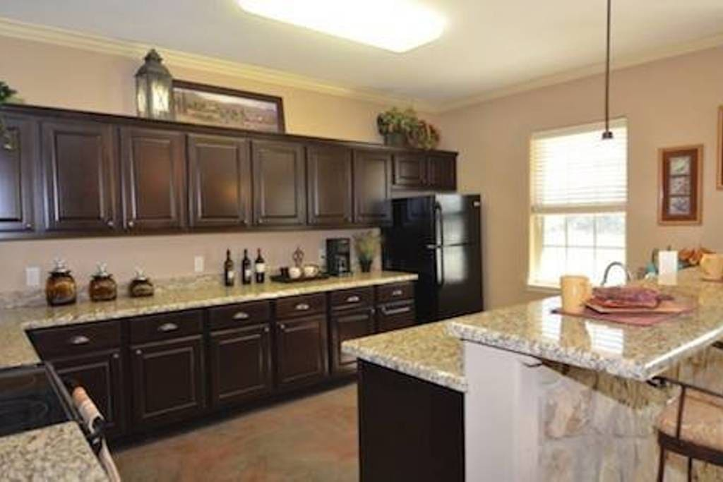 Granite counters, stainless steel sink, freezer/refrigerator space, stove and microwave.