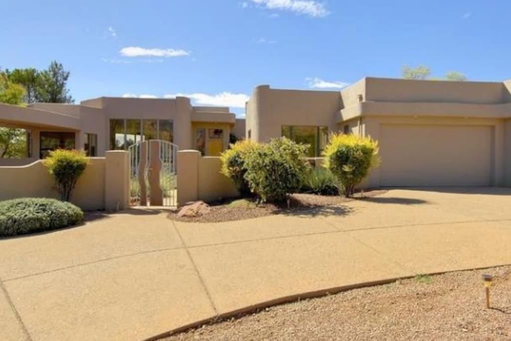 Private two Car Garage leading o Gated CourtYard. + Driveway parking for  4 vehicles