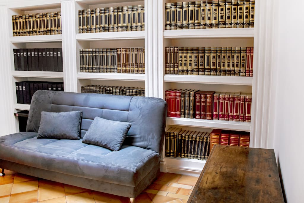This photo shows another smaller and comfortable living space. As well as this there is a large collection of historical and important books regarding both Italy and Sorrento.