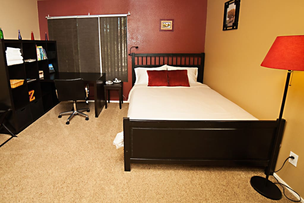 Your private bedroom with work desk. Your feet will love the plush carpet!