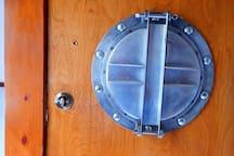 Lockable porthole door uses same key code as front door.