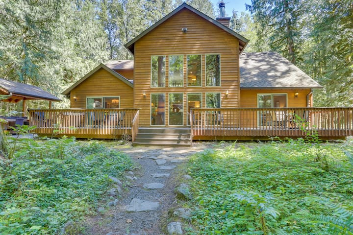 Classic riverfront home w/ great views, game room, hot tub, & modern cabin feel