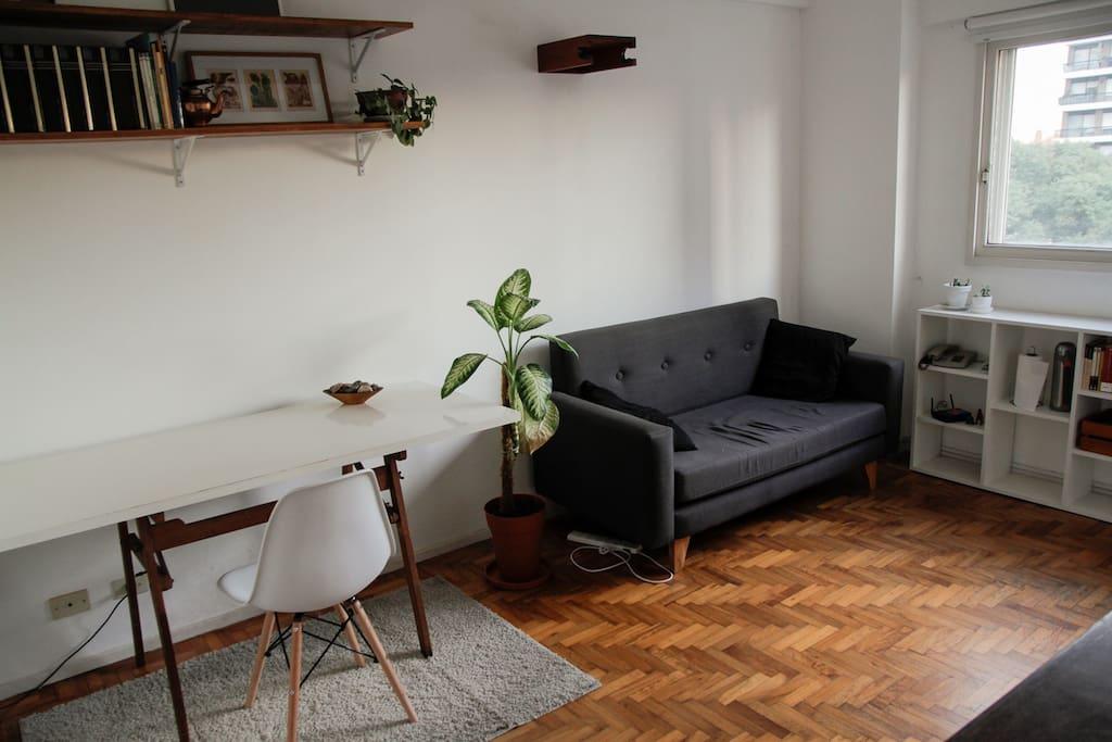 Livingroom with desk and sofa