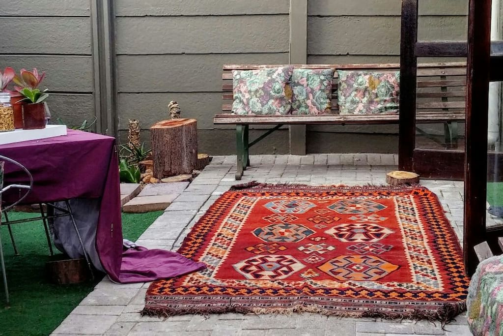 patio. all soft furniture needs to be taken in during evenings. aswell as antique area rug.