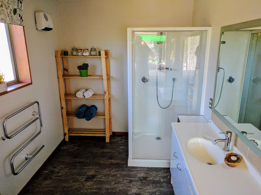 Ensuite bathroom includes toilet, shower and sink
