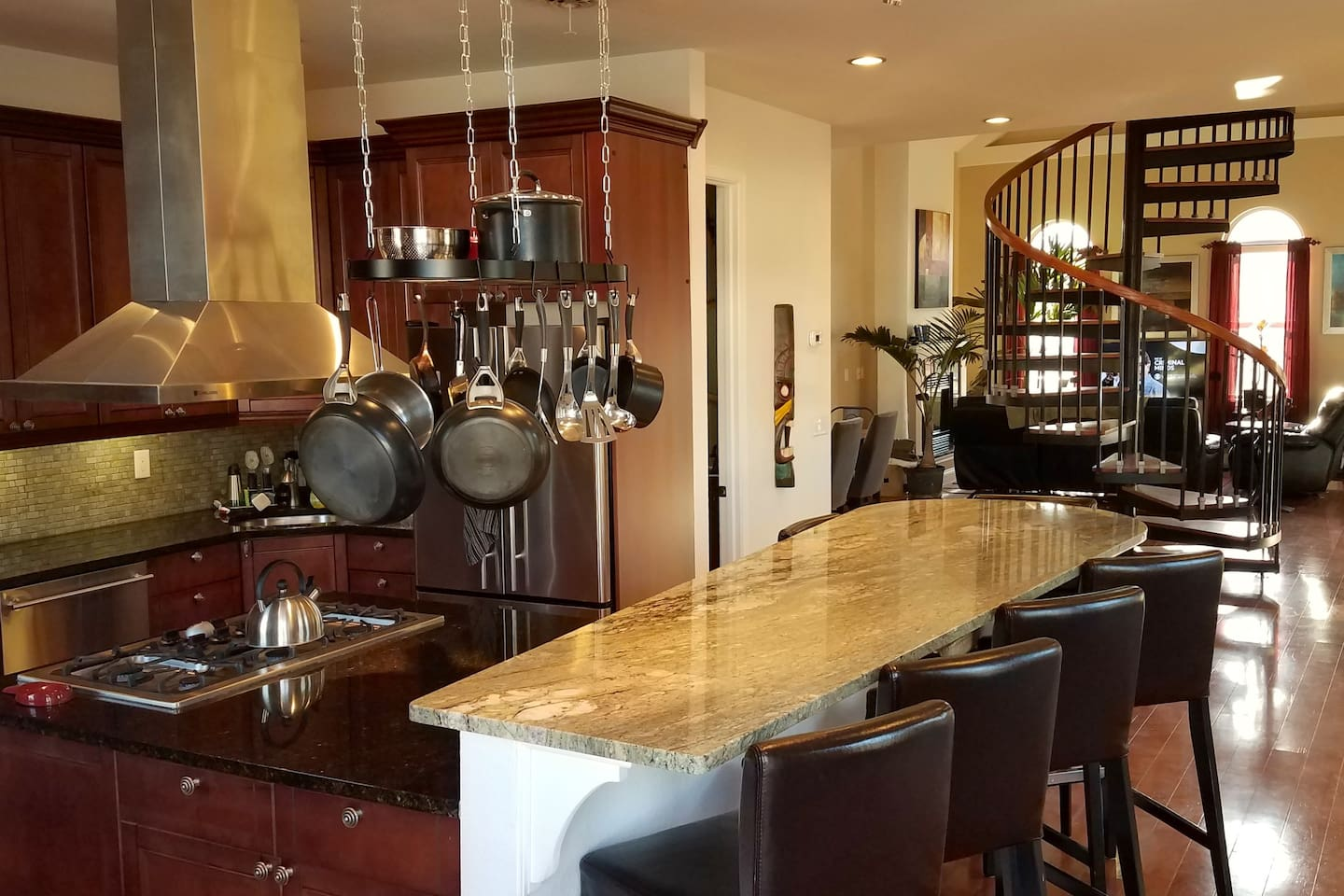 Main level includes Gourmet Kitchen, Half-Bath, Dining, Entertainment, Fireplace, and Office area in open floor plan.
