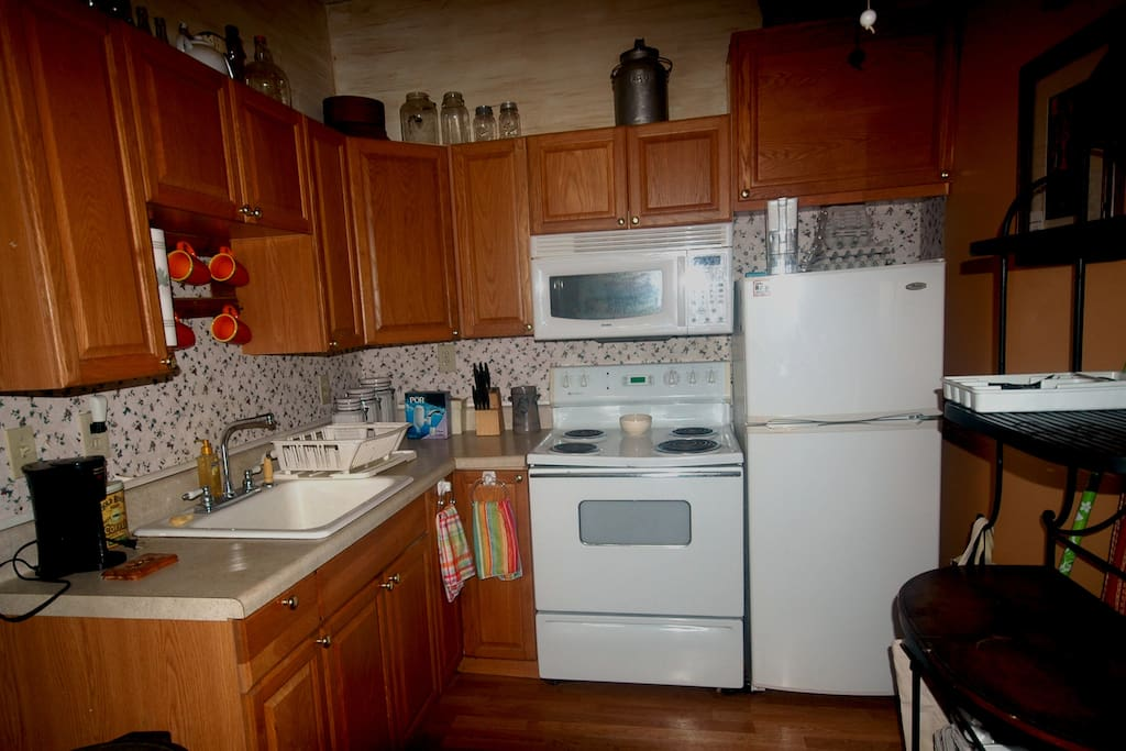 Full kitchen with microwave, coffee maker, refrigerator and farm sink with all the regular utensils needed for cooking that special someone a great country meal. we offer grocery pickup so your food will be ready for you when you arrive, message us your grocery list and payment info before you arrive.