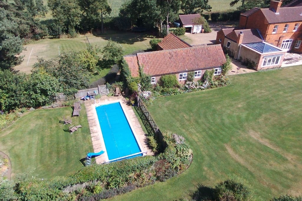 Cottage, pool garden, grass tennis court and main house