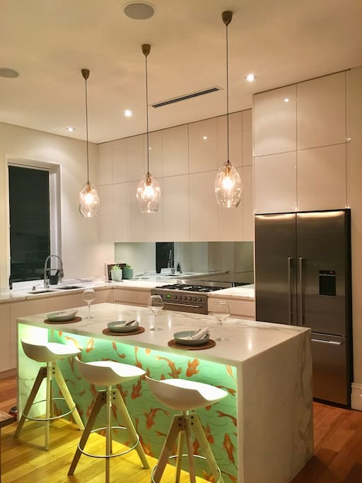 Beautiful open spacious marble kitchen with high end appliances.