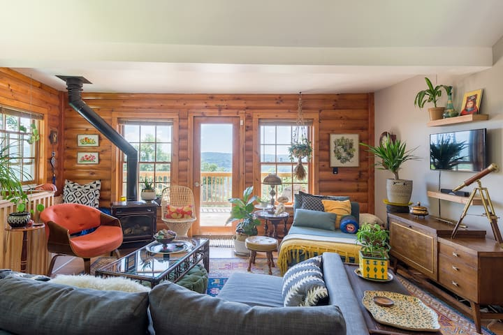 The spacious living room has plenty of soft seating for everyone, and tons of sunshine through the windows to the big upper deck.
