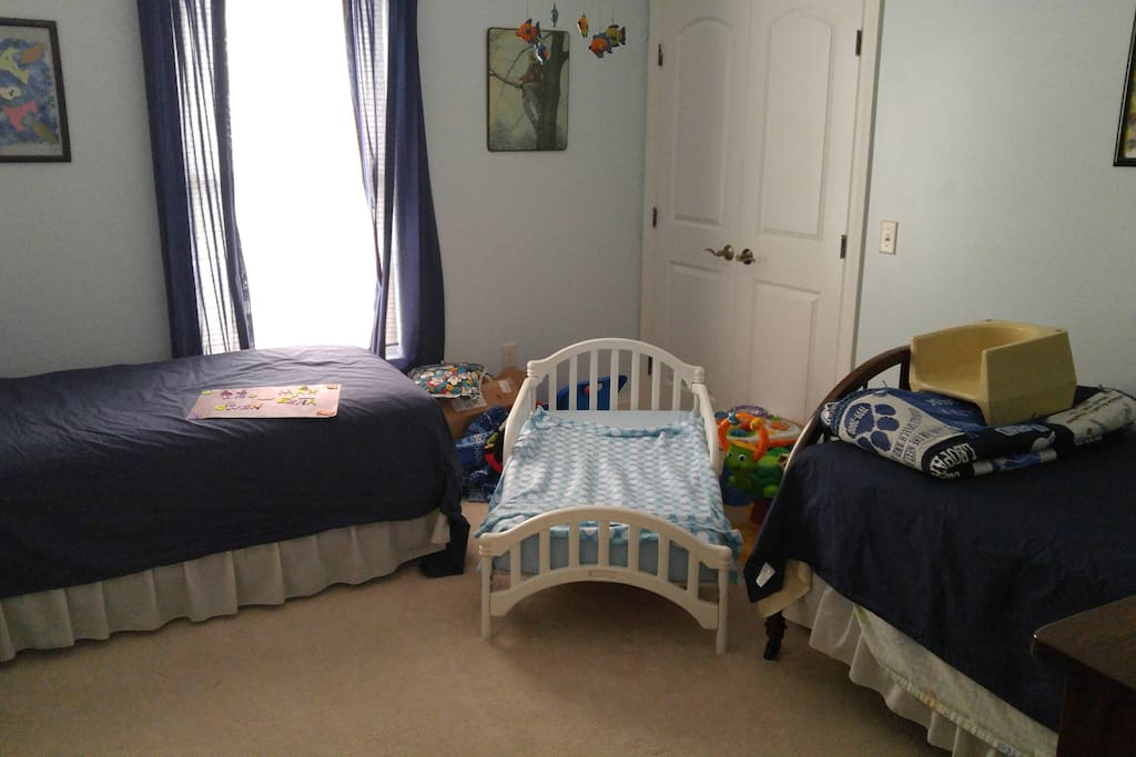 "The Blue Room has two single beds and can accommodate a ""toddler bed"" It shares the Jack & Jill bathroom."