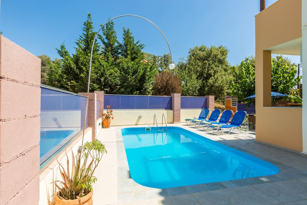 Outdoor area with Swimming pool, Sun beds & Sun umbrellas