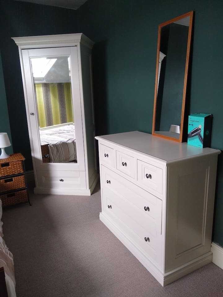 Wardrobe and chest of drawers in bedroom 1.