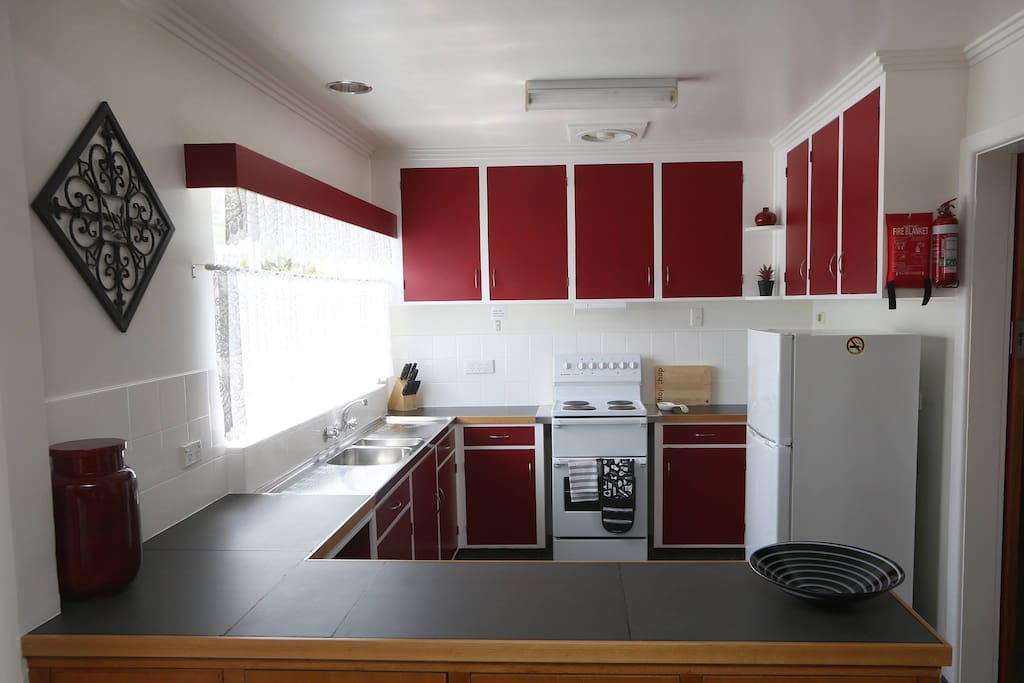 This well equipped kitchen has a large Fridge/Freezer and full sized stove.