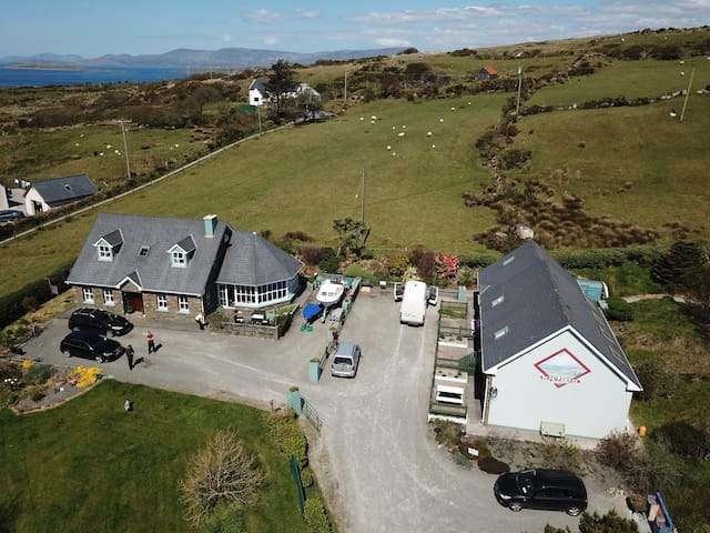Inches House & Cottages taken from the South looking North with Kenmare bay and the Ring of Kerry in the background.