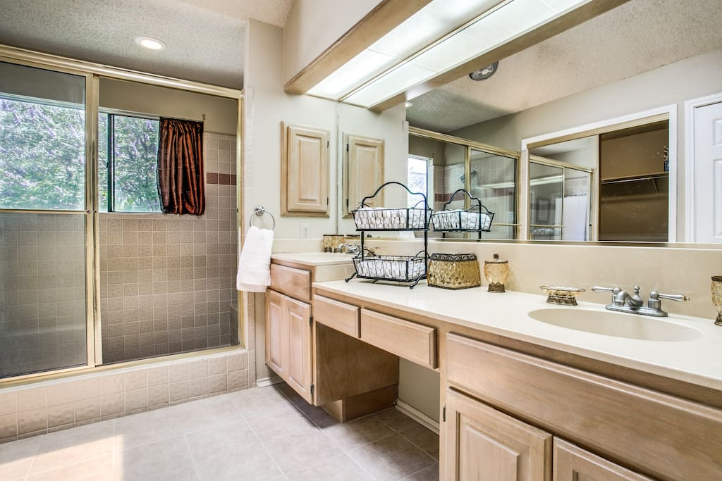 Very spacious main bathroom with a large walking closed and huge shower