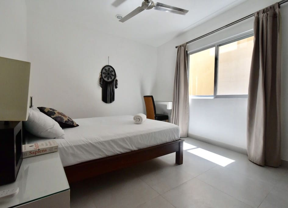 Bedroom with fan and AC
