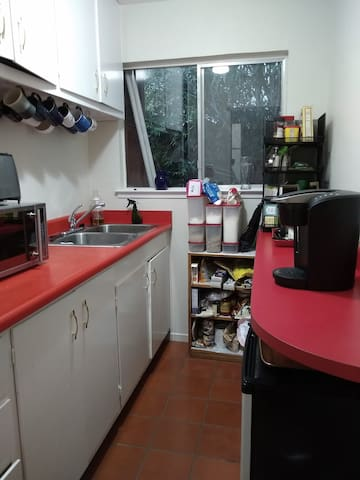 Shared butlers pantry includes mini-fridge, microwave, toaster, sink, and coffee maker. (Plus dishes, cutting boards, etc.)