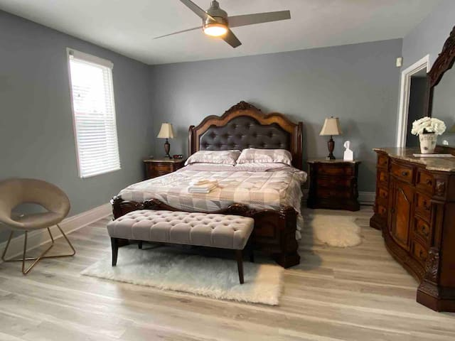 Spread your things out in the large master bedroom with a plush king size bed, large smart TV, and closet with plenty of storage