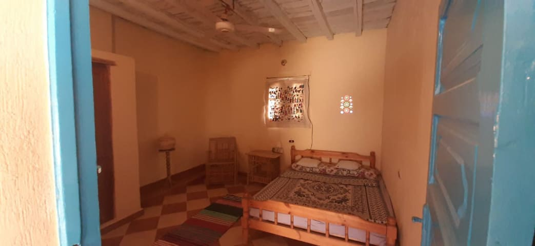 """The second room"" - 1,50 matress, ceiling fan und wardrobe"
