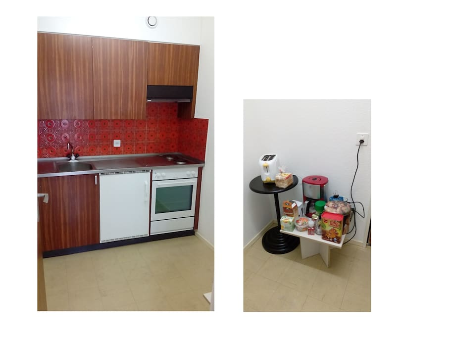 A build-in kitchen with 2-cooking plates, steam ventilator, oven, and refrigerator-deep freezer